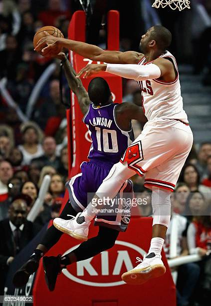 Dwyane Wade of the Chicago Bulls blocks a shot by Ty Lawson of the Sacramento Kings at the United Center on January 21 2017 in Chicago Illinois The...