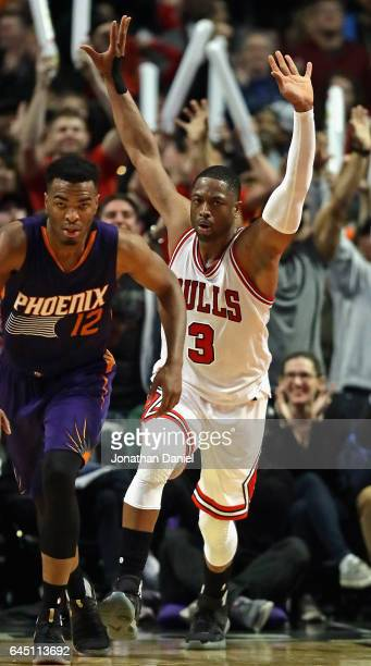 Dwyane Wade of the Chicago Bulls celebrates after dunking over Alex Len of the Phoenix Suns at the United Center on February 24 2017 in Chicago...