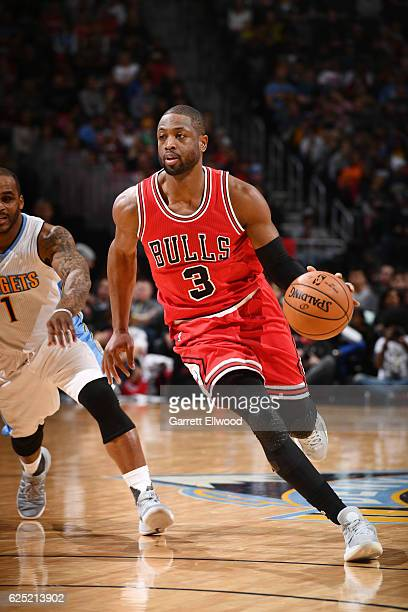 Dwyane Wade of the Chicago Bulls drives to the basket against the Denver Nuggets during the game on November 22 2016 at the Pepsi Center in Denver...