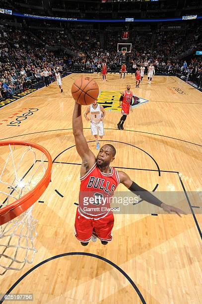 Dwyane Wade of the Chicago Bulls dunks against the Denver Nuggets during the game on November 22 2016 at the Pepsi Center in Denver Colorado NOTE TO...