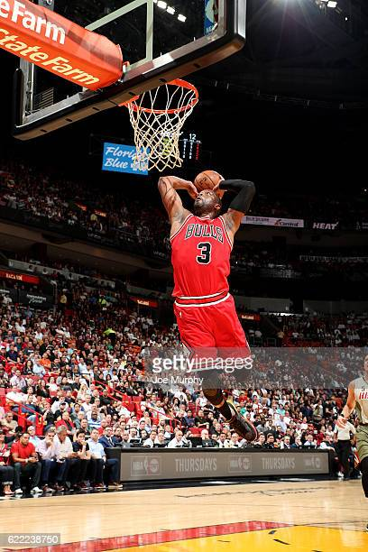 Dwyane Wade of the Chicago Bulls dunks the ball during the game against the Miami Heat on November 10 2016 at AmericanAirlines Arena in Miami Florida...