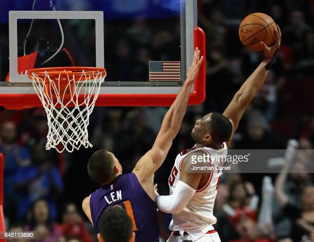 Dwyane Wade of the Chicago Bulls goes up for a dunk over Alex Len of the Phoenix Suns at the United Center on February 24 2017 in Chicago Illinois...