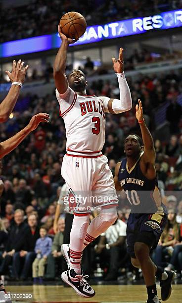 Dwyane Wade of the Chicago Bulls goes up for a shot past Langston Galloway of the New Orleans Pelicans at the United Center on January 14 2017 in...
