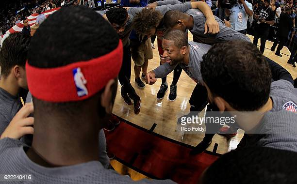 Dwyane Wade of the Chicago Bulls huddles with teammates before the game against the Miami Heat at American Airlines Arena on November 10 2016 in...