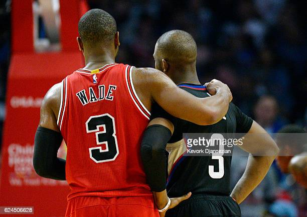 Dwyane Wade of the Chicago Bulls hugs Chris Paul of the Los Angeles Clippers during the second half of the basketball game at Staples Center November...