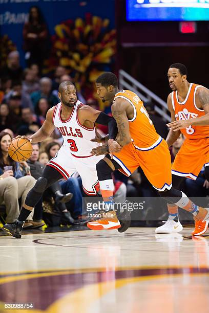 Dwyane Wade of the Chicago Bulls looks for a pass around DeAndre Liggins of the Cleveland Cavaliers during the first half at Quicken Loans Arena on...