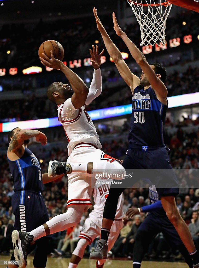 Dwyane Wade #3 of the Chicago Bulls puts up a shot against Salah Mejri #50 of the Dallas Mavericks at the United Center on January 17, 2017 in Chicago, Illinois. The Mavericks defeated the Bulls 99-98.