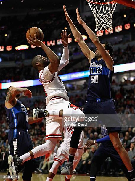 Dwyane Wade of the Chicago Bulls puts up a shot against Salah Mejri of the Dallas Mavericks at the United Center on January 17 2017 in Chicago...