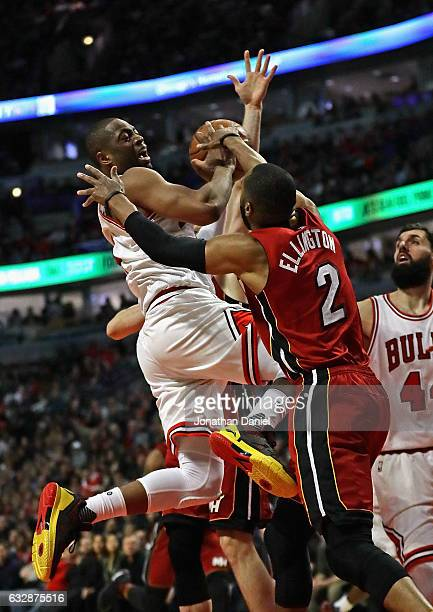 Dwyane Wade of the Chicago Bulls tries to drive against Wayne Ellington of the Miami Heat at the United Center on January 27 2017 in Chicago Illinois...