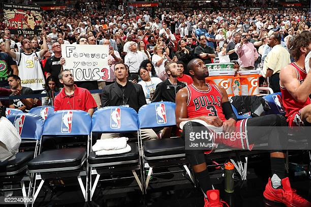 Dwyane Wade of the Chicago Bulls watches the tribute video before the game against the Miami Heat on November 10 2016 at AmericanAirlines Arena in...