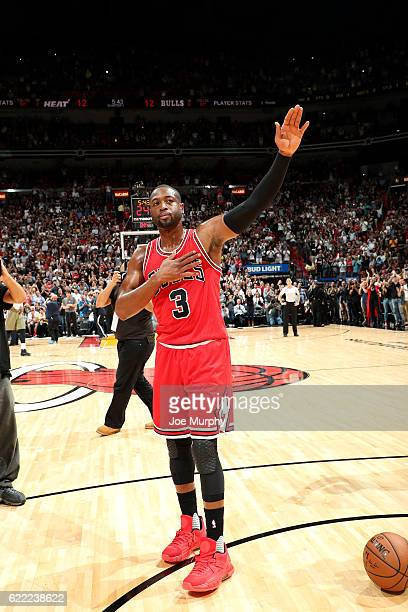 Dwyane Wade of the Chicago Bulls waves to the crowd before the game against the Miami Heat on November 10 2016 at AmericanAirlines Arena in Miami...