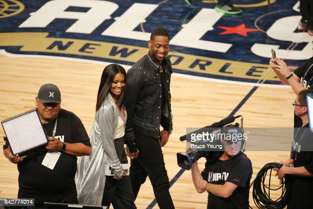Dwyane Wade of the Chicago Bulls with his wife and actress Gabrielle Union are seen during the JBL ThreePoint Contest during State Farm AllStar...