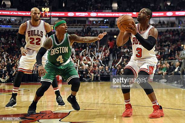 Dwyane Wade of the Chicago Bulls works against Isaiah Thomas of the Boston Celtics during a game at the United Center on October 27 2016 in Chicago...