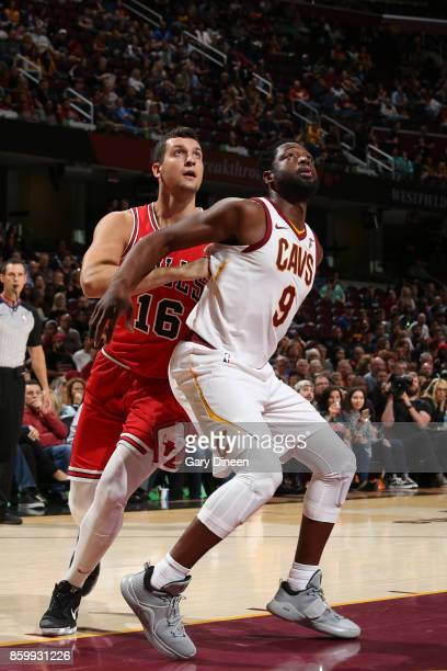 Dwyane Wade of the Cleveland Cavaliers boxes out against Paul Zipser of the Chicago Bulls during a preseason game on October 10 2017 at Quicken Loans...