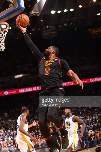 Dwyane Wade of the Cleveland Cavaliers drives to the basket against the Golden State Warriors on December 25 2017 at ORACLE Arena in Oakland...