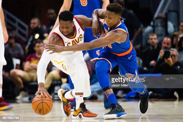 Dwyane Wade of the Cleveland Cavaliers fights to maintain control while under pressure from Frank Ntilikina of the New York Knicks during the first...