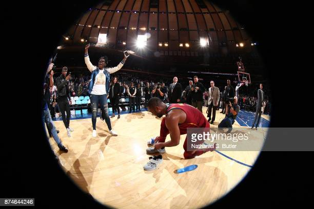 Dwyane Wade of the Cleveland Cavaliers gives Comedian Leslie Jones his shoes after the game against the New York Knicks on November 13 2017 at...