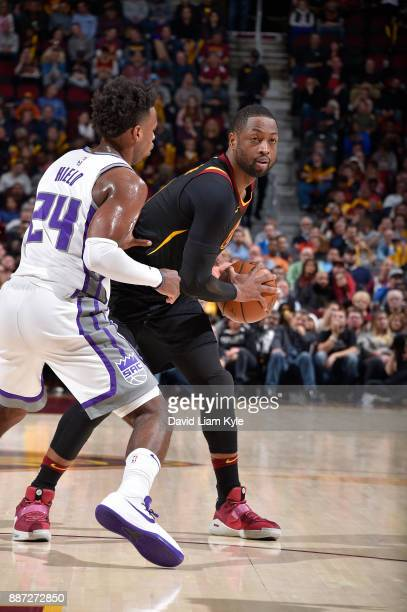 Dwyane Wade of the Cleveland Cavaliers handles the ball against the Sacramento Kings on December 6 2017 at Quicken Loans Arena in Cleveland Ohio NOTE...