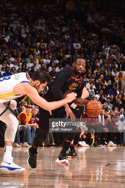 Dwyane Wade of the Cleveland Cavaliers handles the ball against the Golden State Warriors on December 25 2017 at ORACLE Arena in Oakland California...