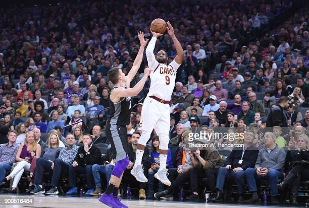 Dwyane Wade of the Cleveland Cavaliers shoots over Bogdan Bogdanovic of the Sacramento Kings during their NBA basketball game at Golden 1 Center on...