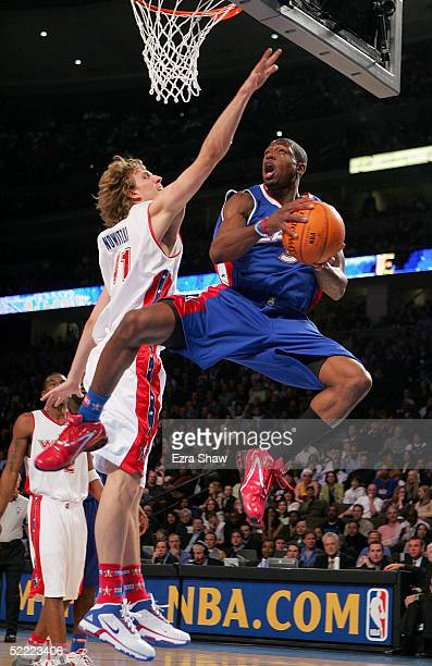Dwyane Wade of the Eastern Conference All-Stars goes to the basket under pressure from Dirk Nowitzki of the Western Conference All-Stars during the...