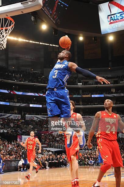 Dwyane Wade of the Eastern Conference AllStars rises for a dunk against the Western Conference AllStars in the 2011 NBA AllStar Game at Staples...