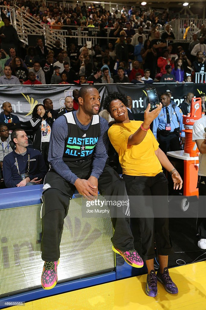 Dwyane Wade #3 of the Eastern Conference All-Stars takes a photo with a member of the military during the NBA All-Star Practices at Sprint Arena as part of 2014 NBA All-Star Weekend at the Ernest N. Morial Convention Center on February 15, 2014 in New Orleans, Louisiana.