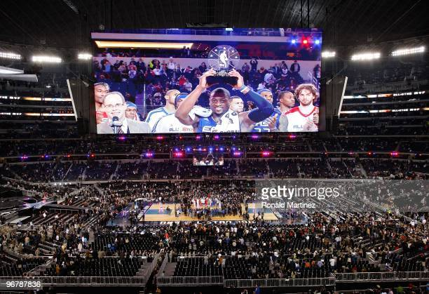Dwyane Wade of the Eastern Conference celebrates with the trophy after being named the MVP of the NBA AllStar Game part of 2010 NBA AllStar Weekend...