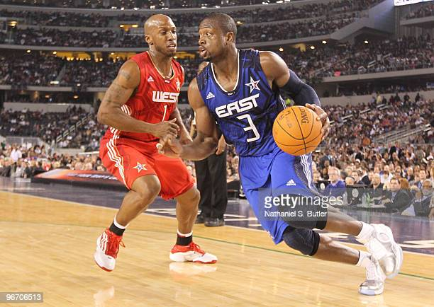 Dwyane Wade of the Eastern Conference drives against Chauncey Billups of the Western Conference during the NBA AllStar Game as part of the 2010 NBA...