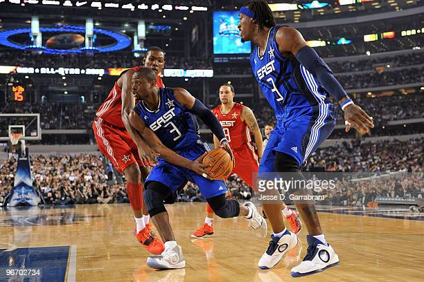 Dwyane Wade of the Eastern Conference drives against Kevin Durant of the Western Conference during the NBA AllStar Game part of 2010 NBA AllStar...