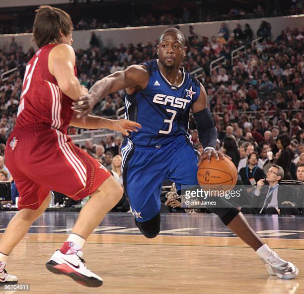 Dwyane Wade of the Eastern Conference drives against Steve Nash of the Western Conference during the NBA AllStar Game as part of the 2010 NBA AllStar...