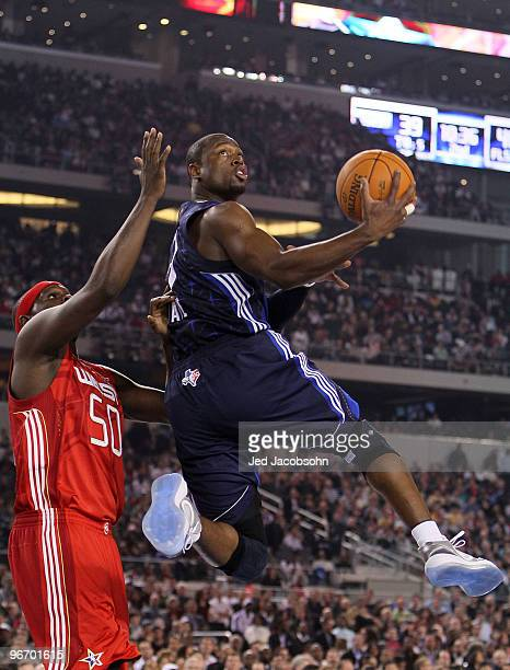 Dwyane Wade of the Eastern Conference goes up for a shot against Zach Randolph of the Western Conference during the first half of the NBA AllStar...