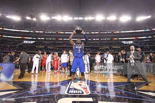 Dwyane Wade of the Eastern Conference hoists his MVP trophy after a win against the Western Conference during the NBA AllStar Game as part of the...