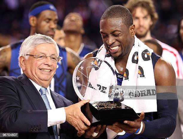 Dwyane Wade of the Eastern Conference is awarded the MVP trophy by NBA Commissioner David Stern after the NBA AllStar Game part of 2010 NBA AllStar...