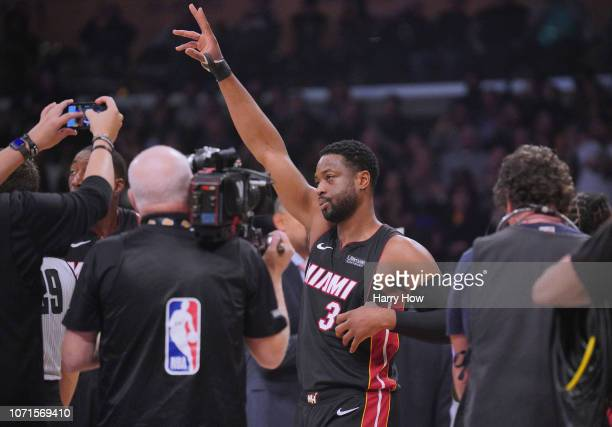 Dwyane Wade of the Miami Heat acknowledges the applause of the crowd after a video tribute during his final game against the Los Angeles Lakers at...