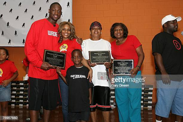 Dwyane Wade of the Miami Heat along with wife Siohvaughn son Zaire mother Minister Jolinda Wade and Christine Johnson mother of NBA Legend Irwin...