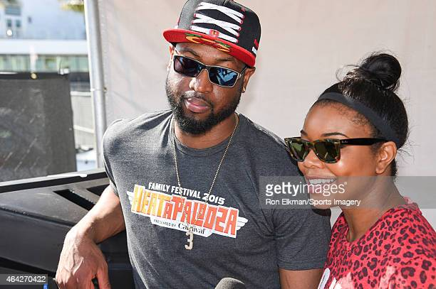Dwyane Wade of the Miami Heat and actress Gabrielle Union look on during the Miami Heat Family Festival at the American Airlines Arena on February 22...