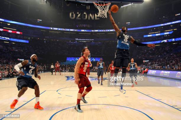 Dwyane Wade of the Miami Heat and and the Eastern Conference drives for a shot attempt against Blake Griffin of the Los Angeles Clippers and the...