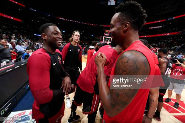 Dwyane Wade of the Miami Heat and Dwight Howard of the Washington Wizards are seen during a preseason game between the Miami Heat and Washington...