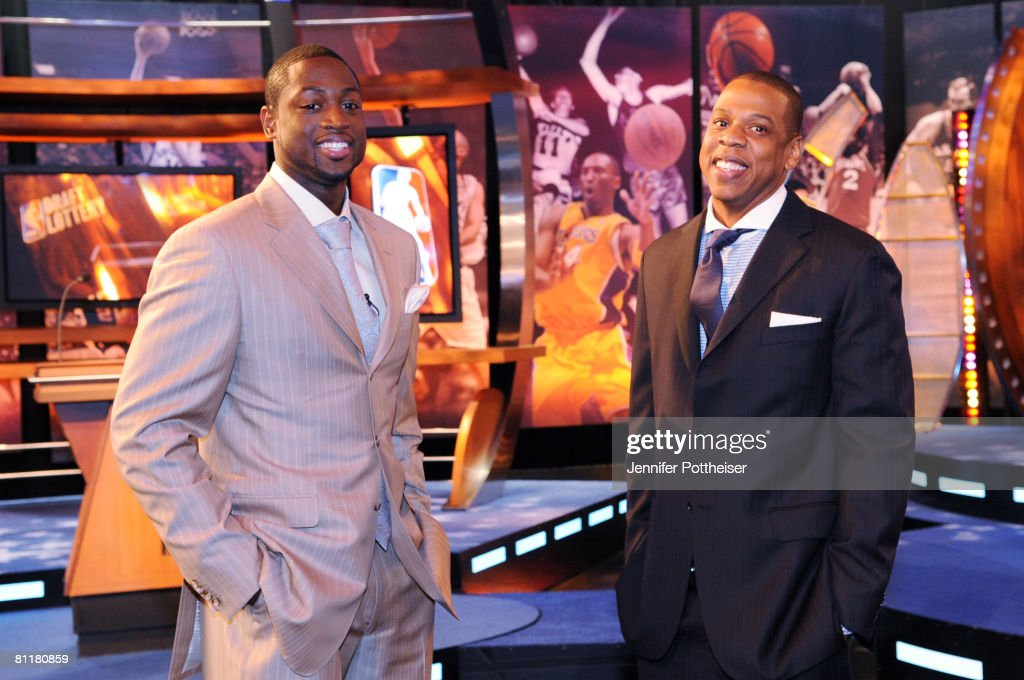 Dwyane Wade (L) of the Miami Heat and Jay-Z, Investor and Minority Owner of the New Jersey Nets share a moment during the 2008 NBA Draft Lottery at the NBATV Studios on May 20, 2008 in Secaucus, New Jersey.