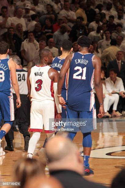 Dwyane Wade of the Miami Heat and Joel Embiid of the Philadelphia 76ers in Game Four of the Eastern Conference Quarterfinals during the 2018 NBA...