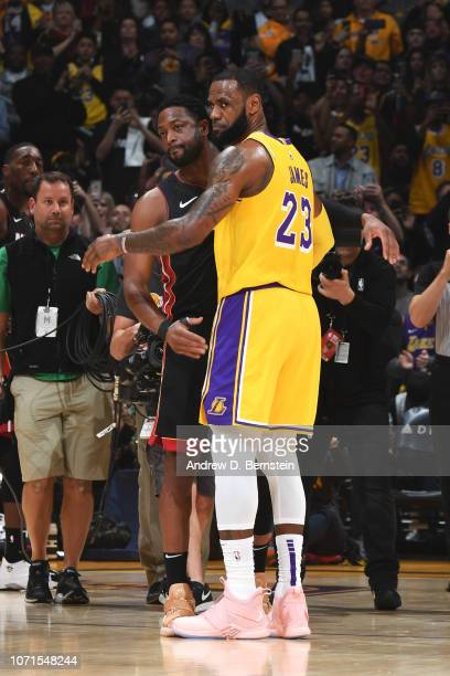 Dwyane Wade of the Miami Heat and LeBron James of the Los Angeles Lakers hug during the game between the two teams on December 10 2018 at STAPLES...