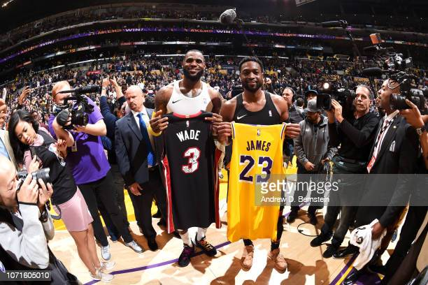 Dwyane Wade of the Miami Heat and LeBron James of the Los Angeles Lakers celebrate after the game between the two teams on December 10 2018 at...