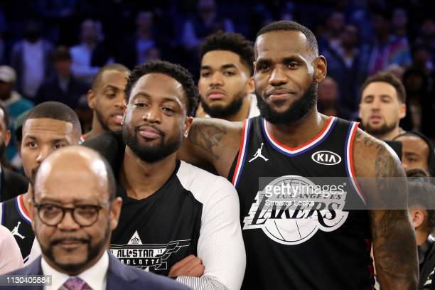 Dwyane Wade of the Miami Heat and LeBron James of the Los Angeles Lakers both of Team LeBron look on during the trophy presentation ceremony after...