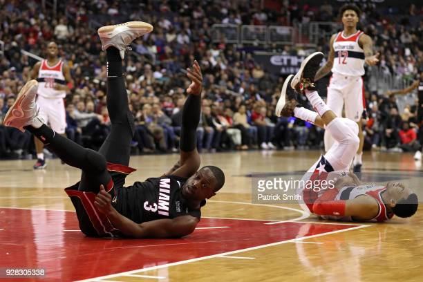 Dwyane Wade of the Miami Heat and Otto Porter Jr #22 of the Washington Wizards collide during the second half at Capital One Arena on March 6 2018 in...