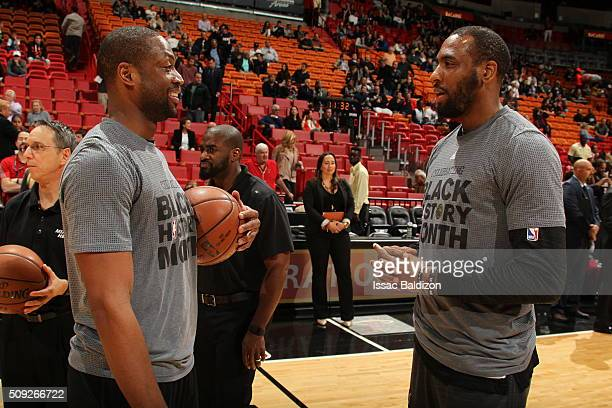 Dwyane Wade of the Miami Heat and Rasual Butler of the San Antonio Spurs talk before the game on February 9 2016 at American Airlines Arena in Miami...