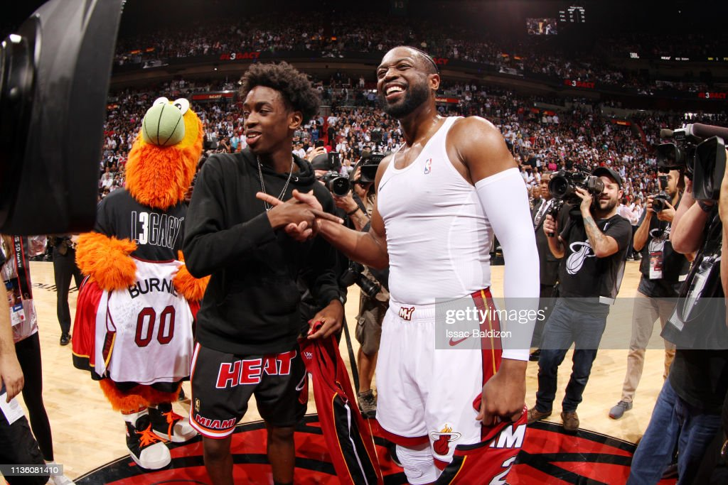 Dwyane Wade of the Miami Heat and son Zaire interact following the