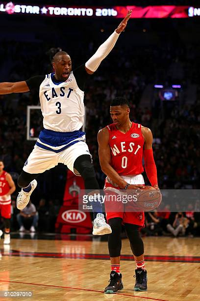 Dwyane Wade of the Miami Heat and the Eastern Conference jumps passed Russell Westbrook of the Oklahoma City Thunder and the Western Conference in...