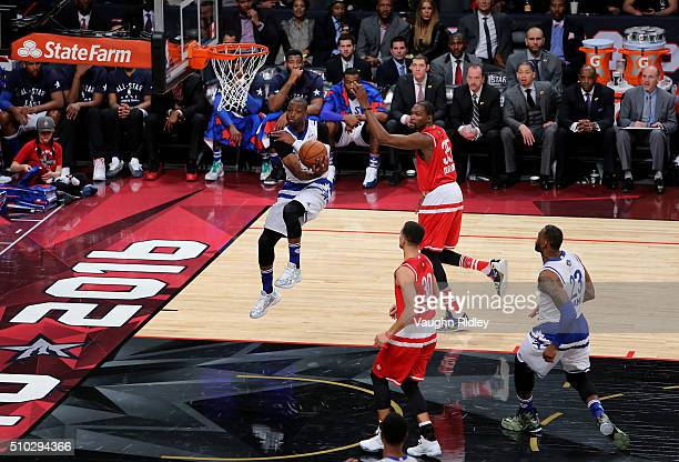 Dwyane Wade of the Miami Heat and the Eastern Conference looks to pass in the first half against the Western Conference during the NBA AllStar Game...