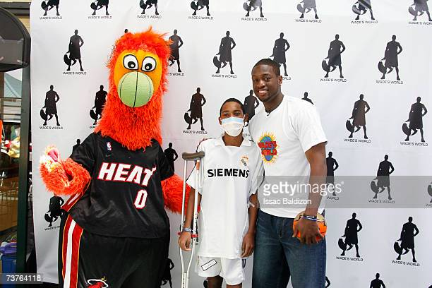 Dwyane Wade of the Miami Heat and the Heat's mascot Burnie visit with patients at the Miami Children's Hospital on April 1 2007 at American Airlines...